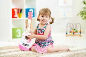 little girl with guitar toy gift