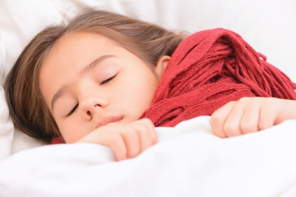 Have a rest. Close up of little cute girl lying in bed and sleeping